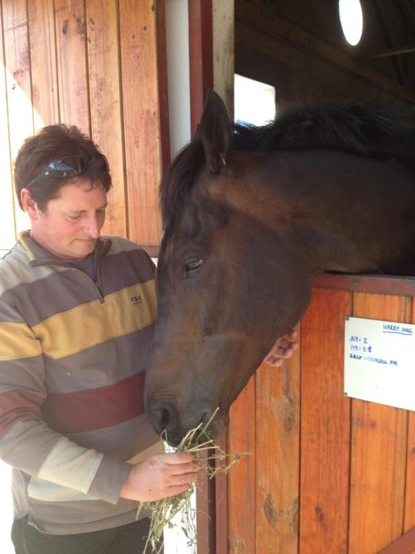 Harry Hall with ernst du Preez in his stalls at Favour Racing